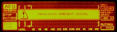 DEQ2496 display showing the MEASURING AMBIENT SIGNAL message.