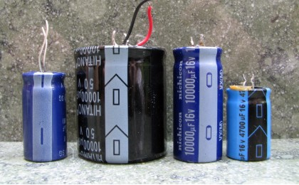 Four electrolytic capacitors showing the negative markings.